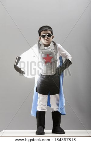 Korean boy in superhero costume holding glowing orb