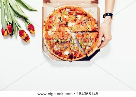Woman Takes A Slice Of Pizza From The Table