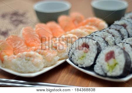 Detail Of Maki Sushi Rolls And Nigiri Sushi With Salmon And Shrimp Japan Food On The Table With Soy