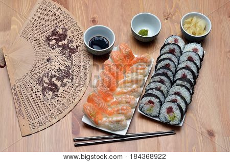 Maki Sushi Rolls And Nigiri Sushi With Salmon And Shrimp Japan Food On The Table With Soy Sauce