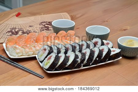 Maki Sushi Rolls And Nigiri Sushi On Plate Japan Food On The Table Detail