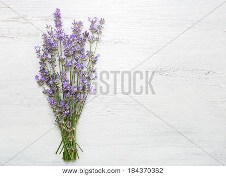 Bundle of lavender on  wooden shabby background.