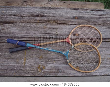 These red and blue rackets are slightly curled with age but suggest an old time game.