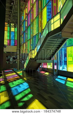 MONTREAL, CANADA - April 23, 2017: Colourful glass panels and stairs in Palais des congres de Montreal (Montreal Convention and Conference Centre)  Montreal, Canada