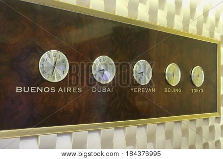 Five clocks are on wall and show different timezones - it is decoration in hotel