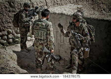 Kabul Afghanistan - circa 2011. Legionnaires of the French Foreign Legion study the terrain for further action during a combat mission in Afghanistan.