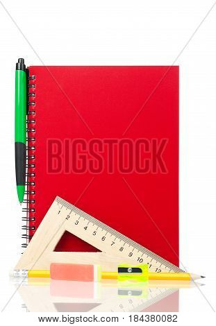 School exercise-book with stationery isolated on white background