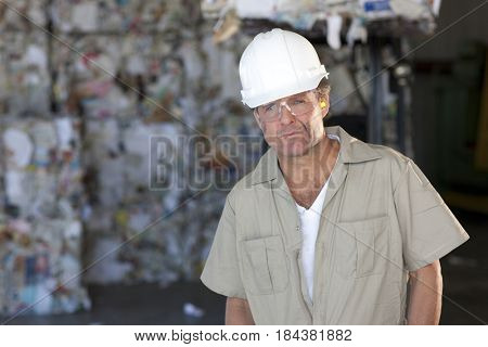 Caucasian sanitation worker working in recycling plant