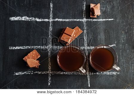 TIC TAC toe with coffee and chocolate.top view.