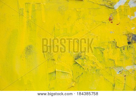 wall with dangling ads shaded in yellow.