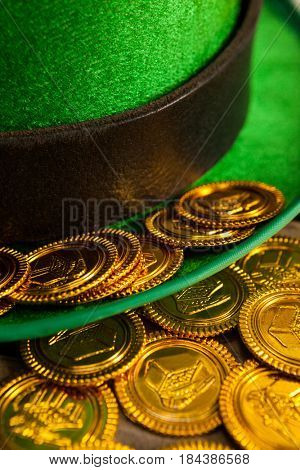 St Patricks Day close-up of leprechaun hat with gold chocolate coins