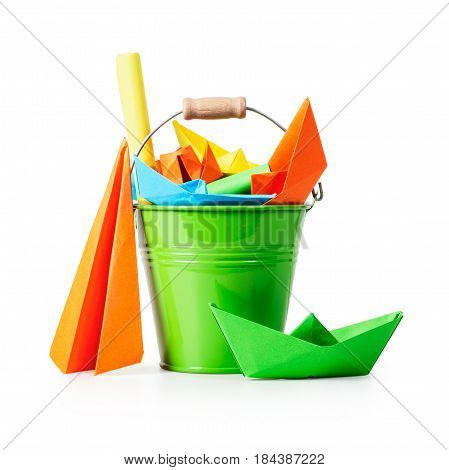 Green bucket with colorful paper sheets and origami toys isolated on white background clipping path included. Children crafts