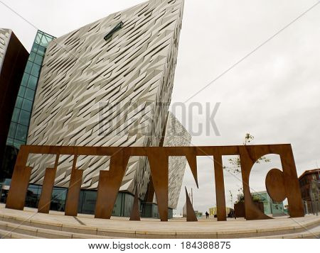 Belfast Northern Ireland - September 01 2014: Titanic sign located in front of the Titanic Museum in Belfast Northern Ireland on a cloudy day. The Titanic Museum opened on March 31 2012.