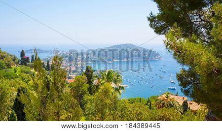 Beautiful Summer Landscape of the French Riviera at Mediterranean Sea. Top View of Luxury resort Villefranche-sur-Mer on Cote d'Azur between Nice and Monaco. Wide screen Horizontal wallpaper. France.