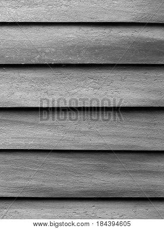 BLACK AND WHITE PHOTO OF THE ROUGH TEXTURE OF WOOD