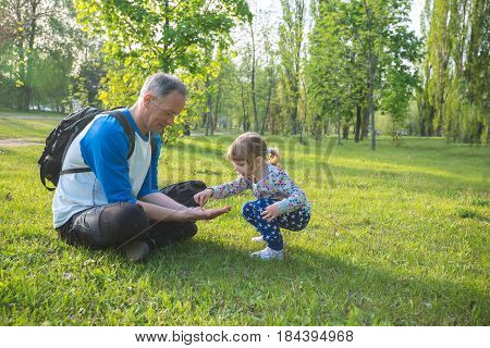 Father With A Little Daughter Are Playing In The Park