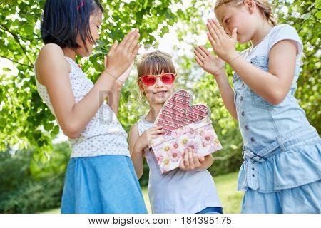 Applause for birthday girl at birthday party