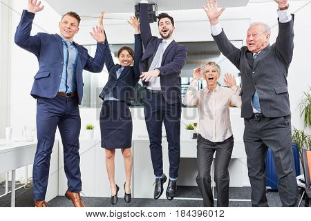 Business team jumping in celebration with enthusiasm for recent success