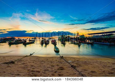 Wooden Fishery Boat On Sand Beach Sunset