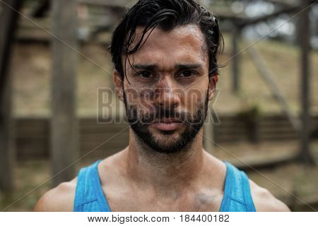 Portrait of determined man in boot camp training during day
