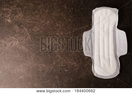 Female white hygienic pads on a dark marble background. Hygiene.