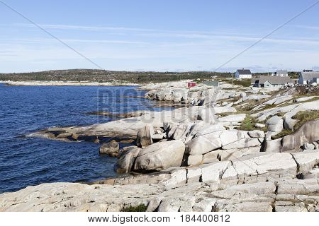 The rocky coastline of Peggy's Cove village the popular touristic site in Nova Scotia (Canada).