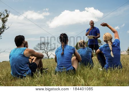 Male trainer taking attendance in the bootcamp