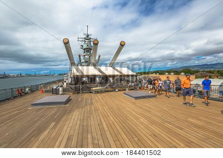 HONOLULU, OAHU, HAWAII, USA - AUGUST 21, 2016: The prow with big cannons of USS Missouri BB-63 warship at Pearl Harbor base. Commissioned in June 1944 for the World War II. Tourists in guided tour.