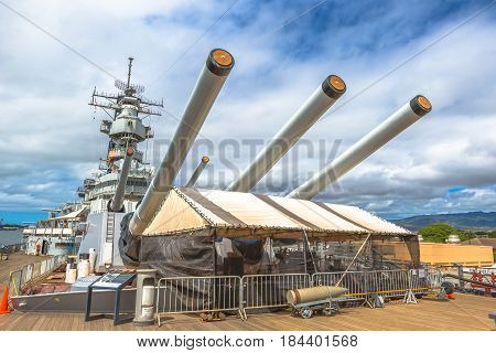 HONOLULU, OAHU, HAWAII, USA - AUGUST 21, 2016: Big cannons of USS Missouri BB-63 warship at Pearl Harbor. Commissioned in June 1944 and served in World War II and many wars in 1950, 1984 and 1991.