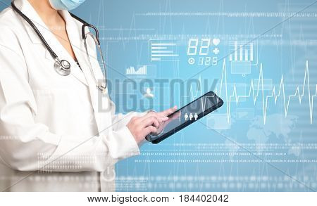 Female doctor holding tablet with blue background and heart related charts