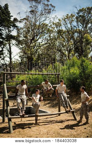 Soldiers sitting on the obstacle course in the bootcamp