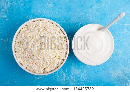 Dairy products on blue background. Yogurt sour cream cottage cheese. Healthy food and diet concept. Copy space. Top view