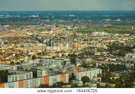 Travel to Germany. View of the houses and streets of Berlin with a bird's-eye view. Overcast sky. Light from the sun on the houses. Residential houses. Megapolis. European city