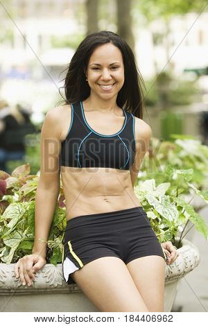 Smiling Hispanic woman in exercise clothing