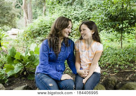 Caucasian mother and daughter holding hands