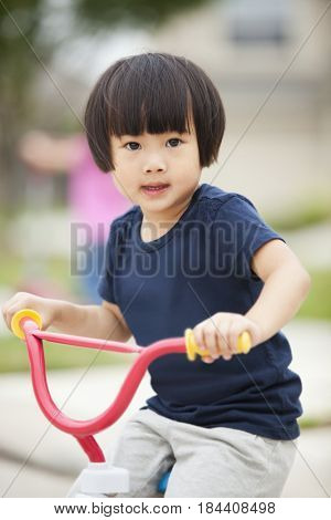 Asian girl riding bicycle