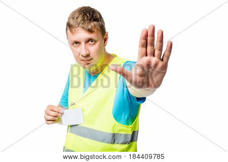 Worker In Yellow Waistcoat Shows Gesture With Hand Gesture Stop On White Background