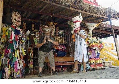 Asian Thai People Traveler Wearing Mask Head With Costume Of Phi Ta Khon Dance And Playing At Phi Ta