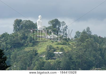 Kandy, Sri Lanka - 18 January 2004: Big Buddha on top of the hill at Kandy on Sri Lanka