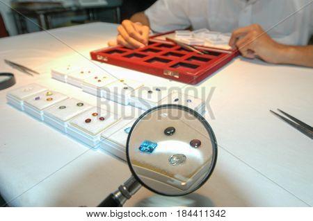 Kandy Sri Lanka - 17 December 2004: The Gemologist expertise in his laboratory fix the value of precious stones at Kandy on Sri Lanka