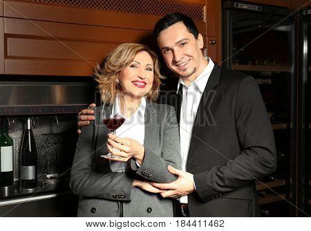 Happy couple in modern wine cellar