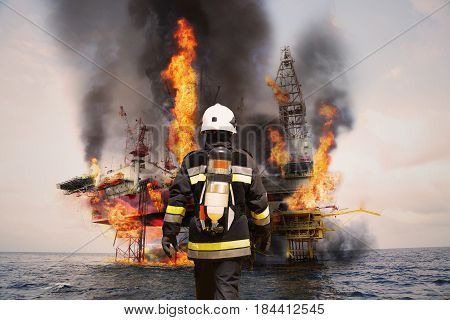 Firefighter in oil and gas industry with mission successful for protect with emergency case or worst case, Personal protective equipment of firefighter team and teamwork for danger mission.