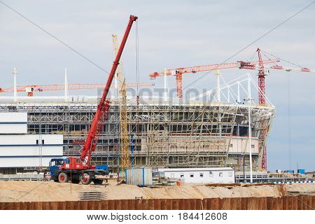Cranes At Work . Stadium Construction. Construction Of Sports Facilities
