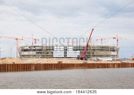 Cranes At Work . Stadium Construction. Construction Of Sports Facilities