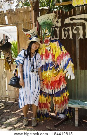 Asian Thai Woman Travelers Wearing Mask Head With Costume Of Phi Ta Khon Dance And Playing At Phi Ta