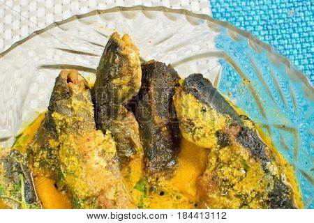 Tyangra fish scientific name - Batasio batasio or Mystus tengara or Macrones vittalus cooked and served in plate. These are very popular fishes in West Bengal (India) and Bangladesh. Bengalis love to eat them.