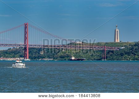 Lisbon Portugal. 29 March 2017.Tejo river and Tejo bridge in Lisbon Tejo bridge links the north and center of Portugal with the south. Lisbon Portugal. photography by Ricardo Rocha.
