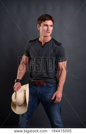 The sexy cowboy is preparing for the big rodeo.
