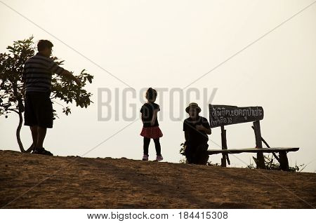 Silhouette of thai family people travel on top of Phu Pa Po mountain or Fuji City Loei at sunrise in Phu Luang Wildlife Sanctuary on February 22 2017 in Loei Thailand