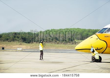Thai Aircraft Marshaller Marshalling And Visual Signal Between Ground Personnel And Pilots On Airpla